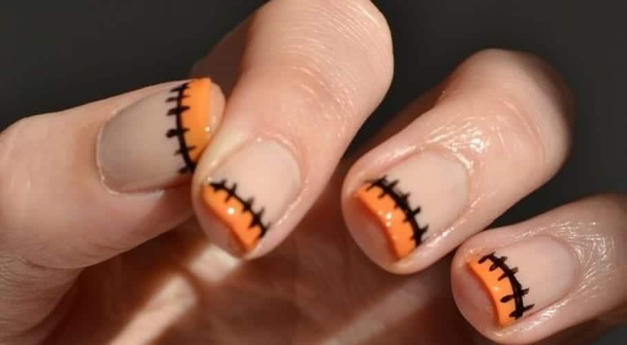 Manicura Halloween en naranja y negro