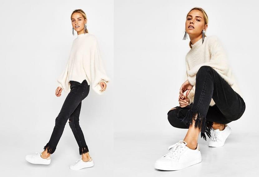 Jeans negros con flecos